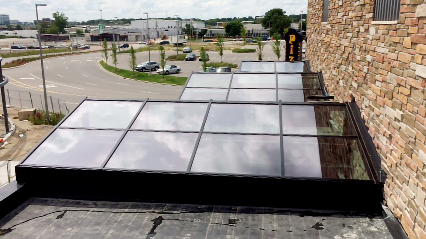 Multiple welded curb straight-eave lean-to skylights.