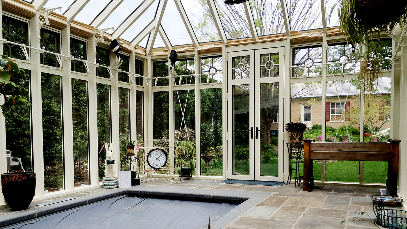 A pool enclosure with 2 hip ends and a hip end cupola.