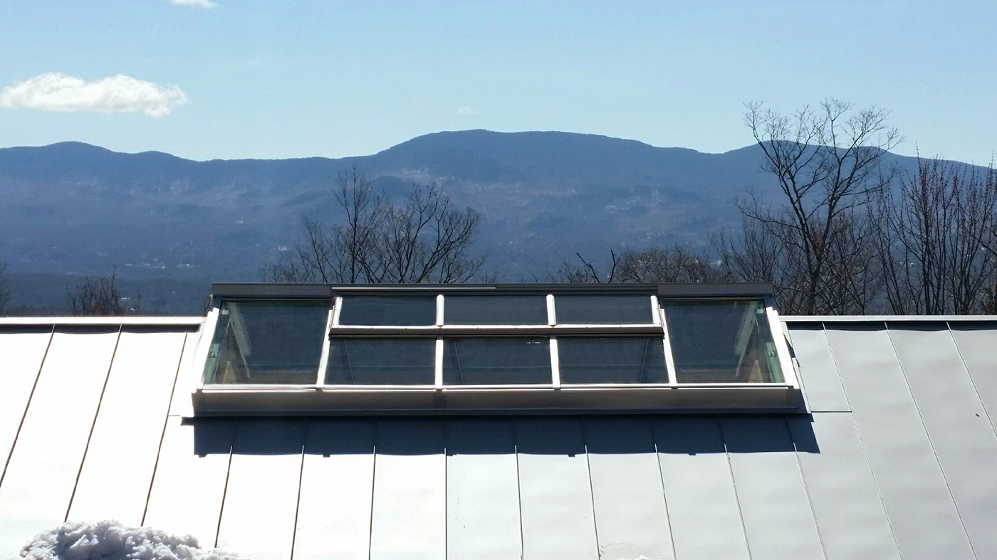 Double pitch skylight with ridge vents