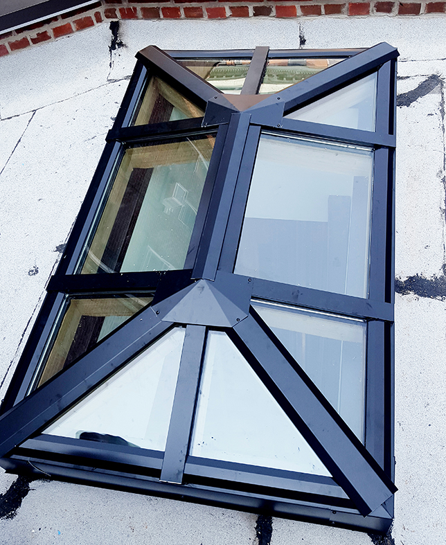 Straight eave double pitch skylights