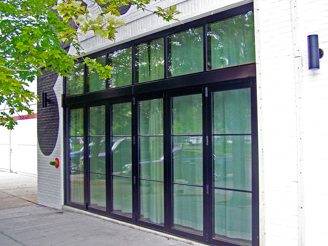 Curtain walls with terrace and bifold door integration