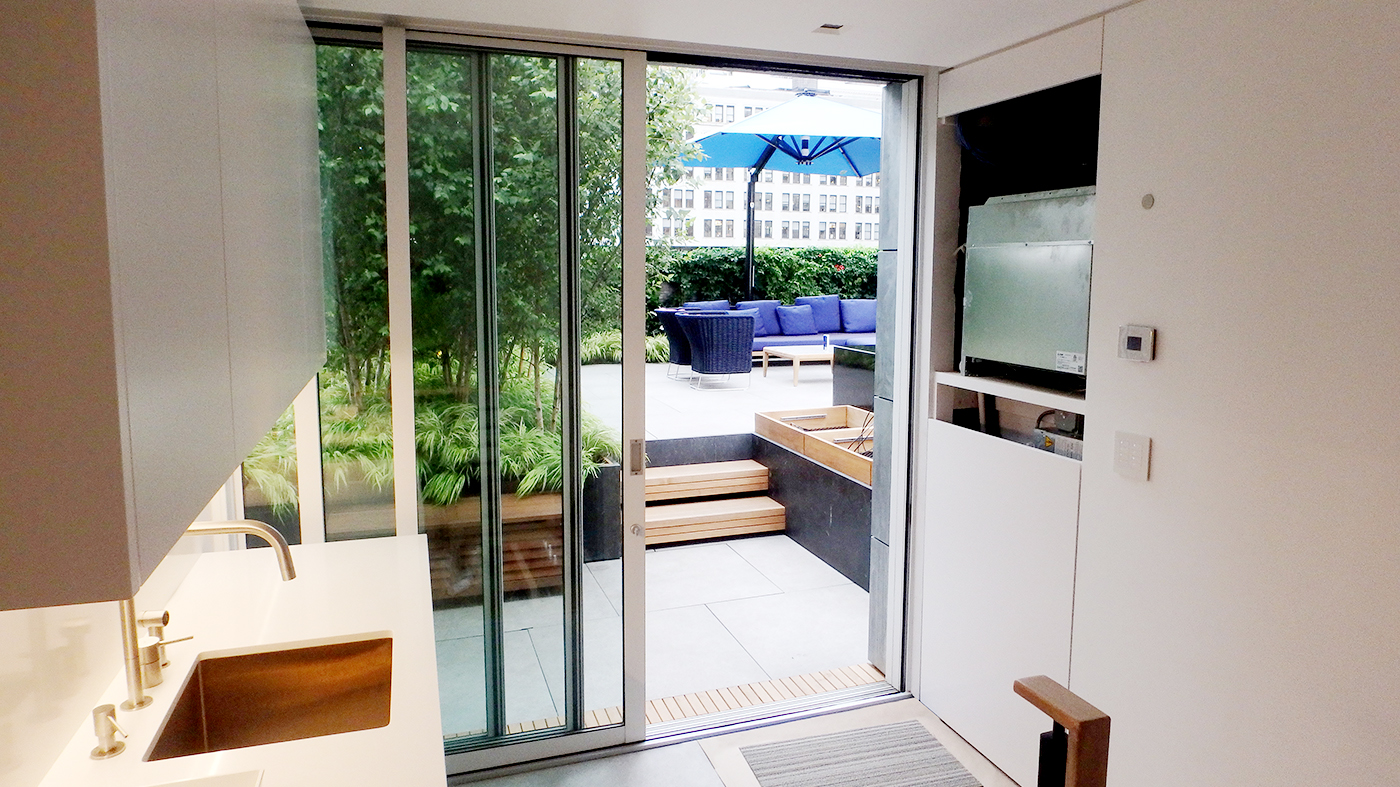 This sliding glass door is a great transition to this patio.