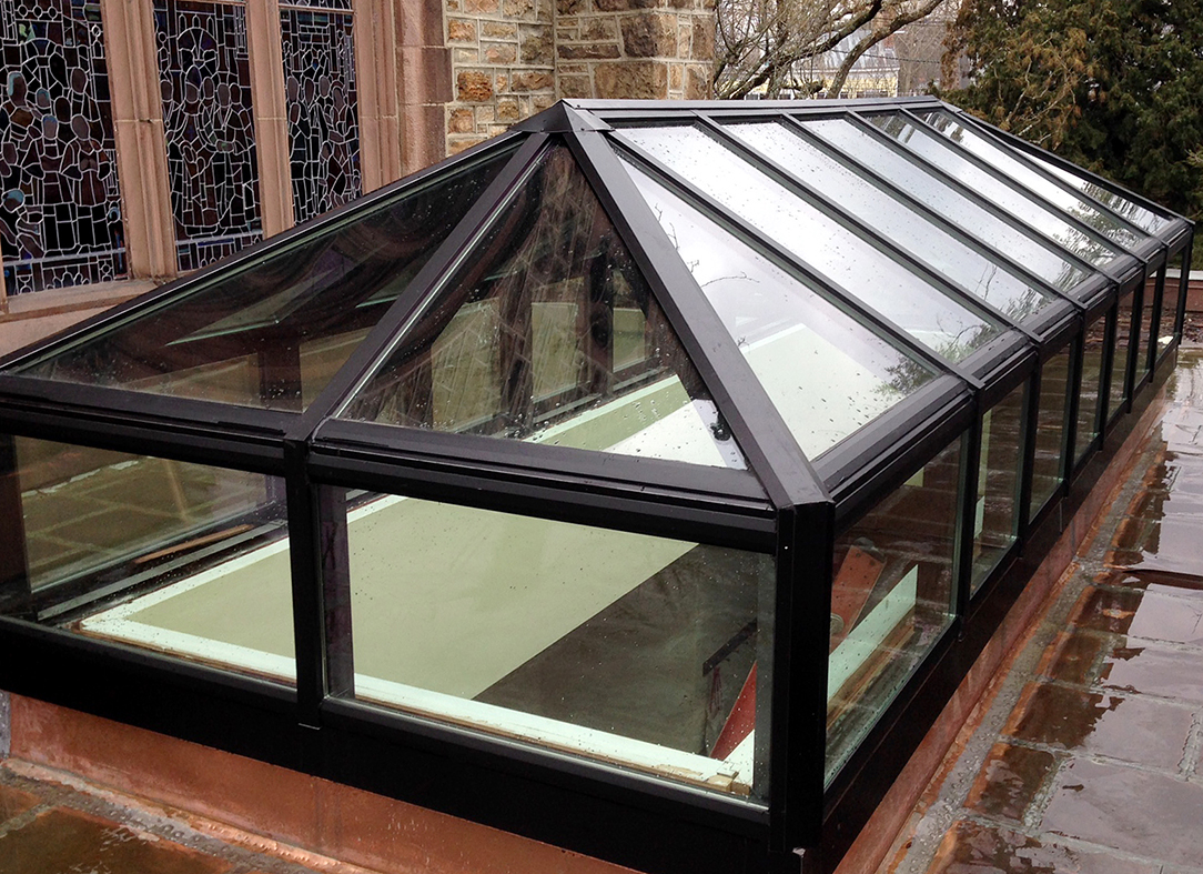 This aluminum double-pitch lantern skylight was installed in a commercial setting. This type of skylight allows daylight to enter a space as well as a view of the outdoors.
