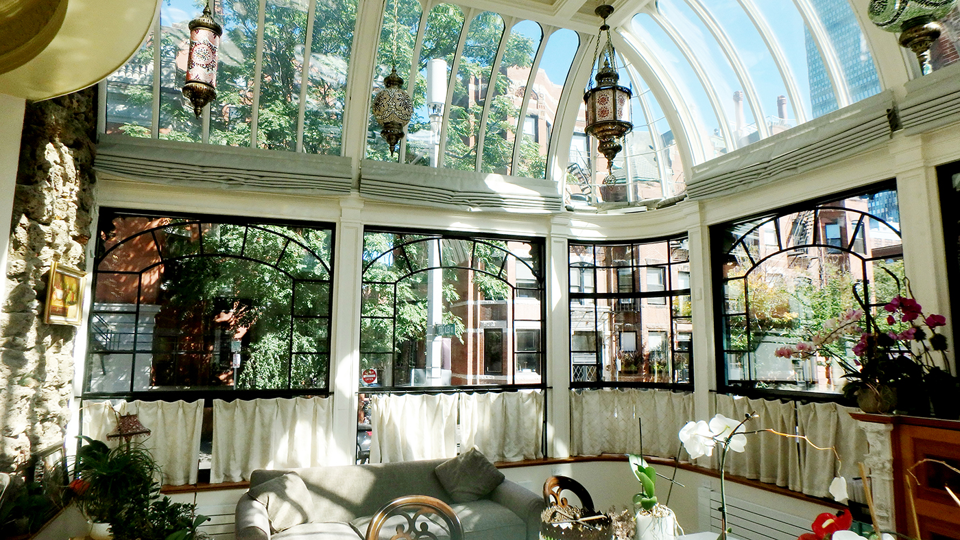 Restoration project on conservatory with aluminum curtain walls and radius glazing