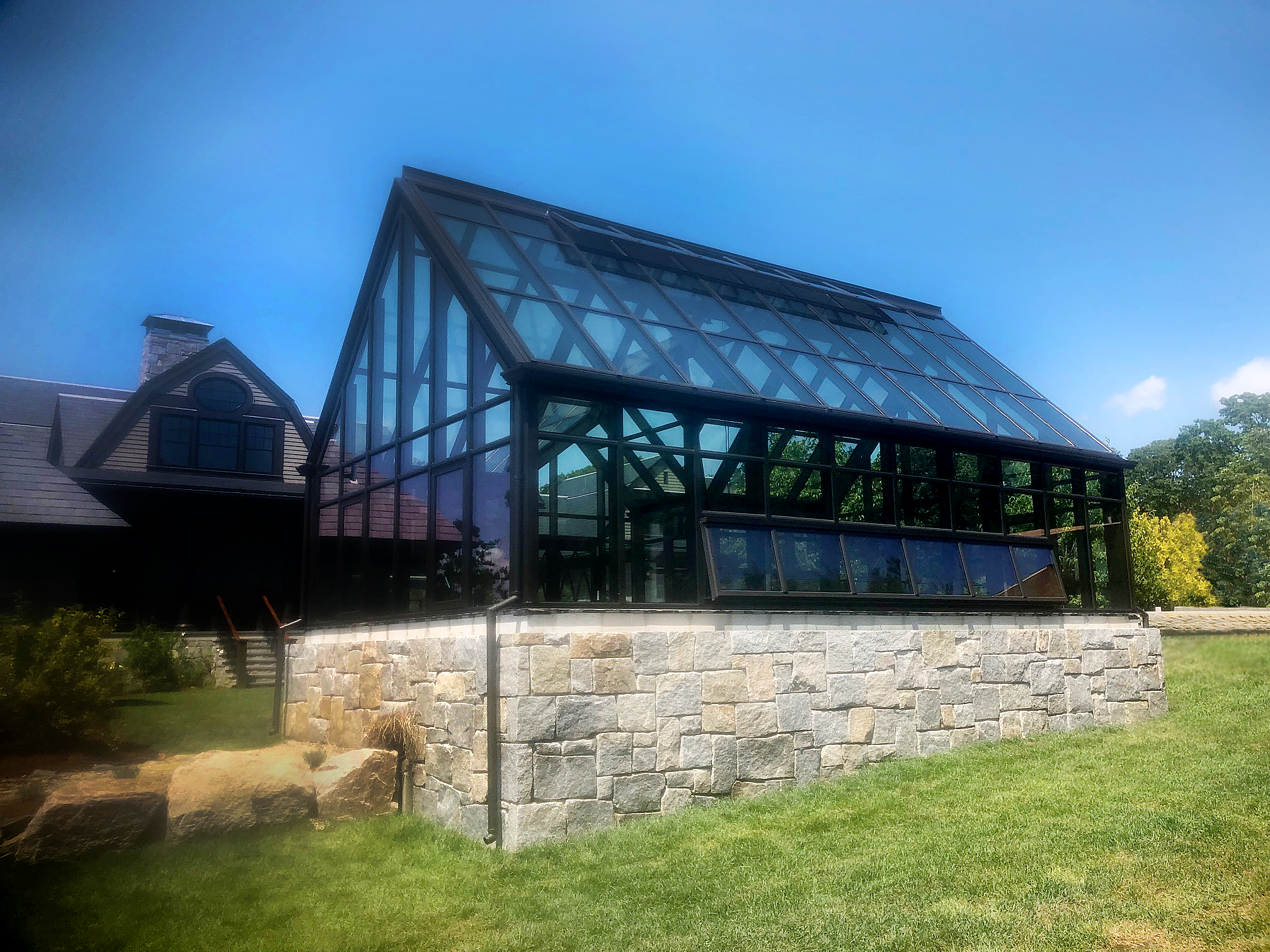 Greenhouse with gothic arch grid doors