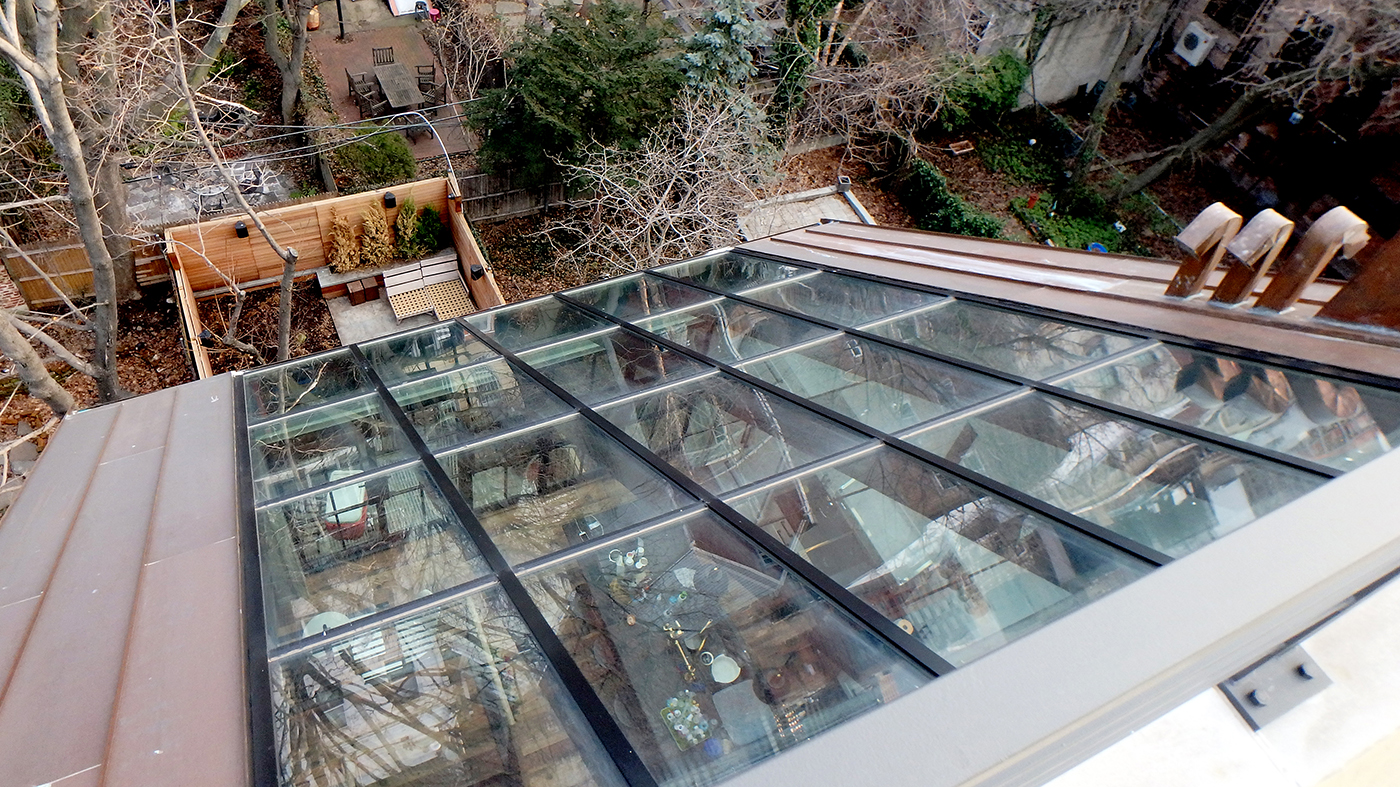 Single slope skylight/curtain wall