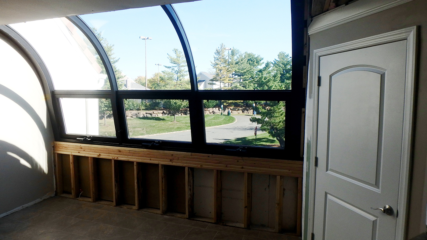 Curved eave Lean to sunroom