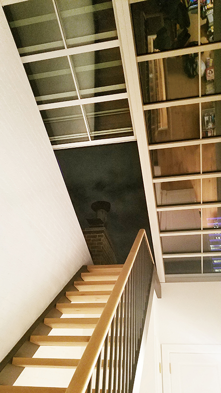 Straight eave double pitch retractable skylight