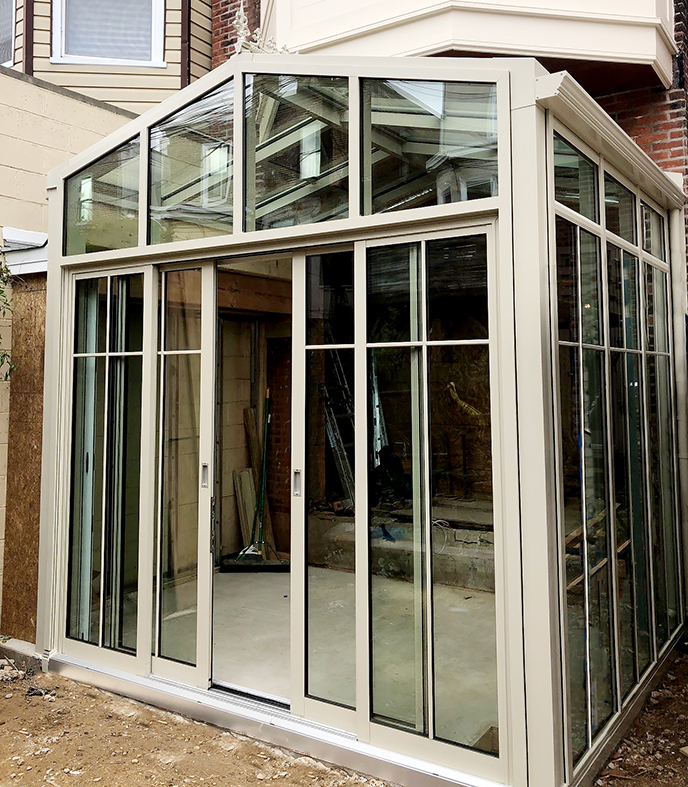 Straight eave double pitch sunroom with multi-track sliding glass doors and B-Series screens