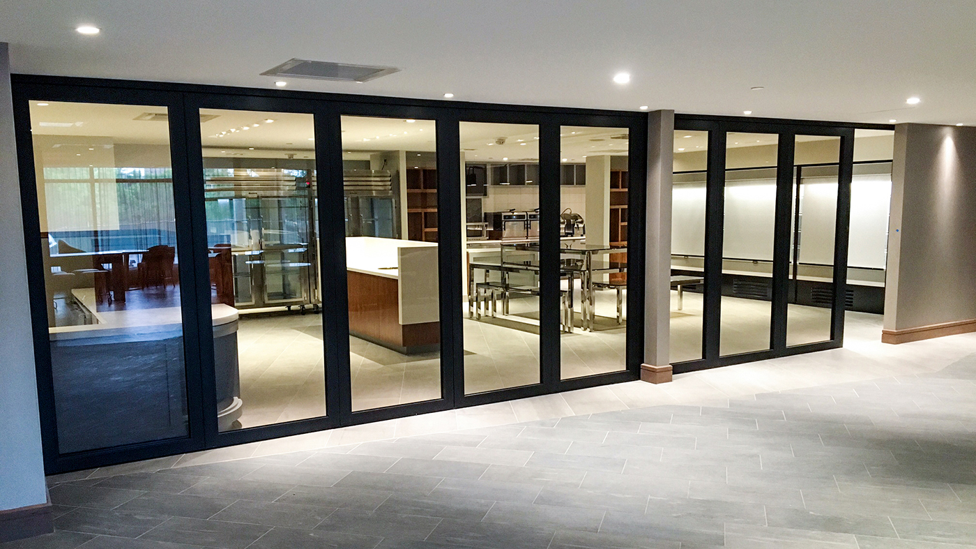 This Slide and Stack Glass Wall system allows the customer to open the kitchen up to the dining area.