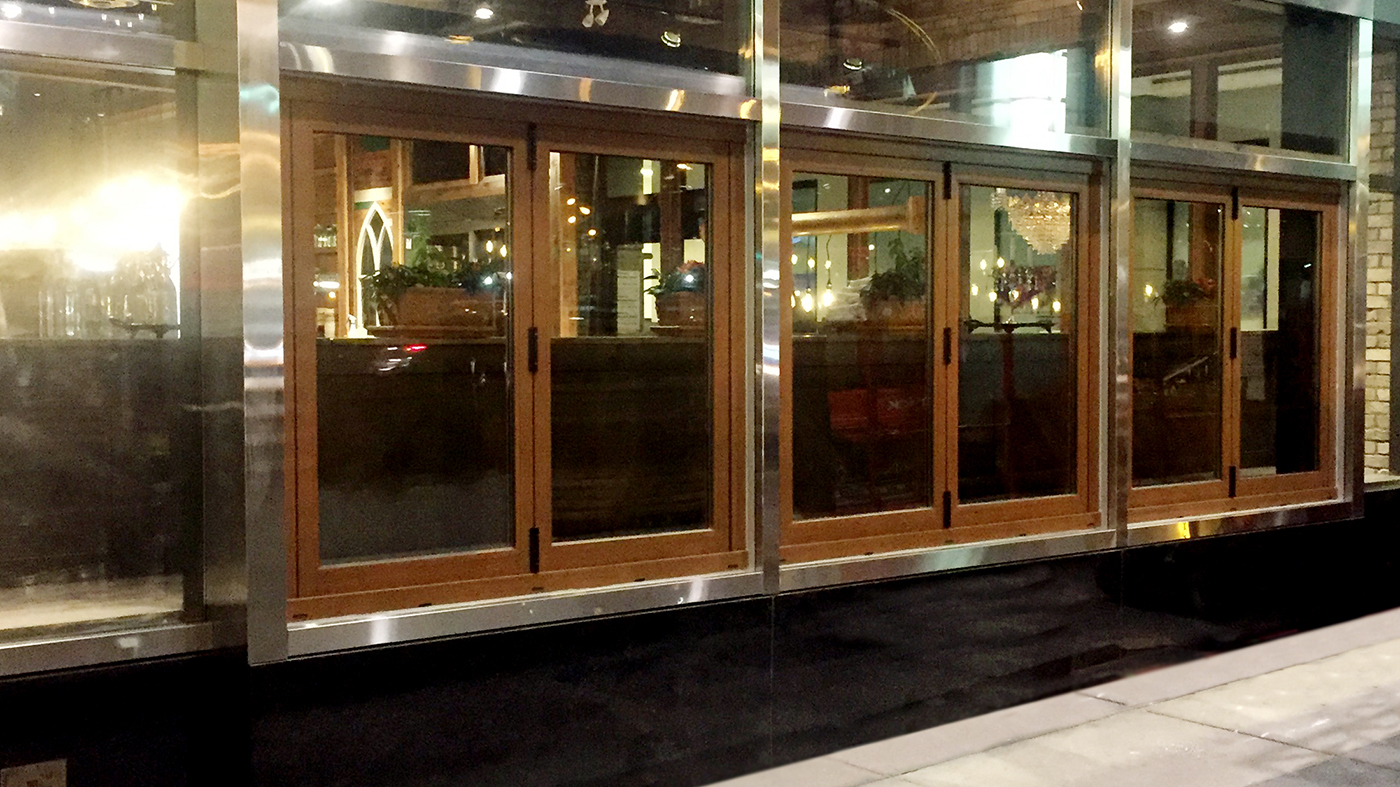 Bifold windows, French and terrace doors with Cherry Decoral powder coat simulated wood grain finish