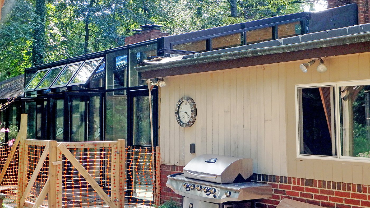 Straight eave lean-to sunroom with four awning and casement windows and one terrace door