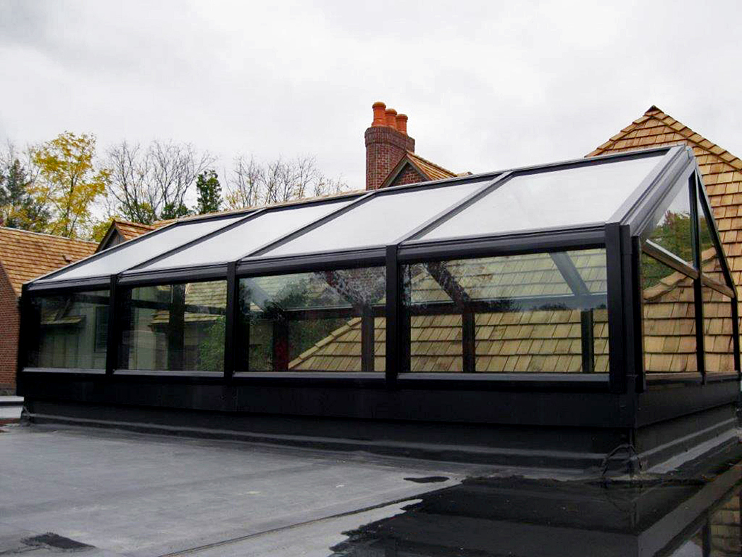 Straight eave double pitch skylight with transom
