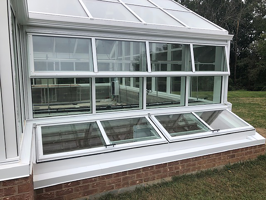 Greenhouse with built-in cold frames