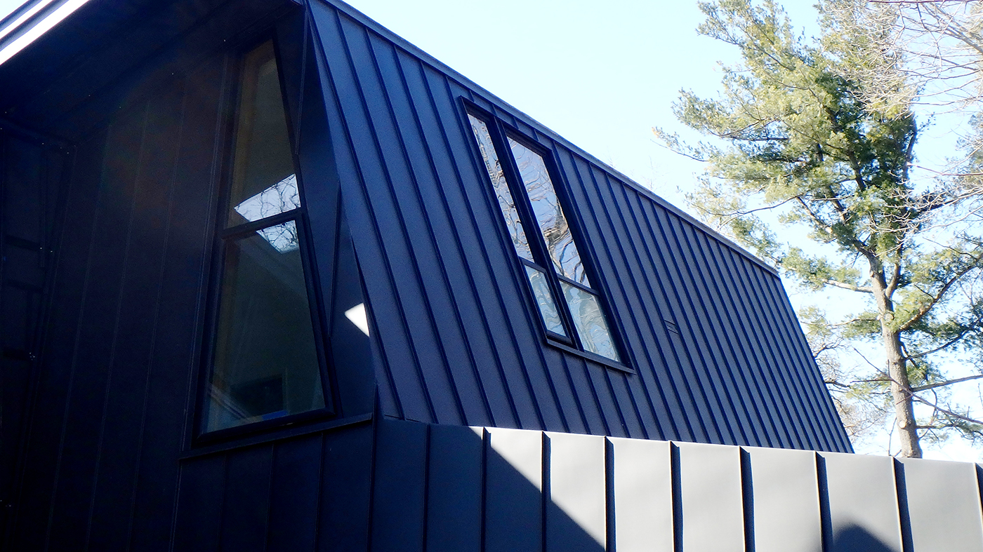 Aluminum curtain walls with integrated awning windows and swing doors