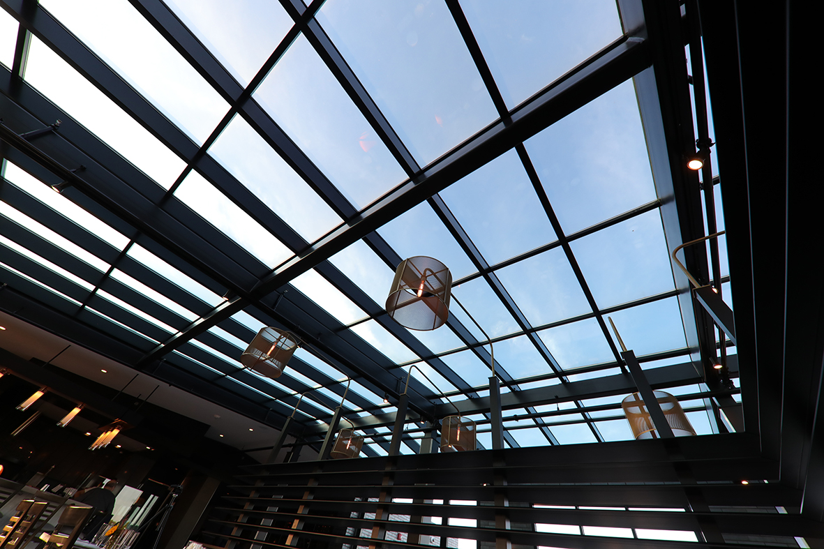Double pitch skylight with bifold doors