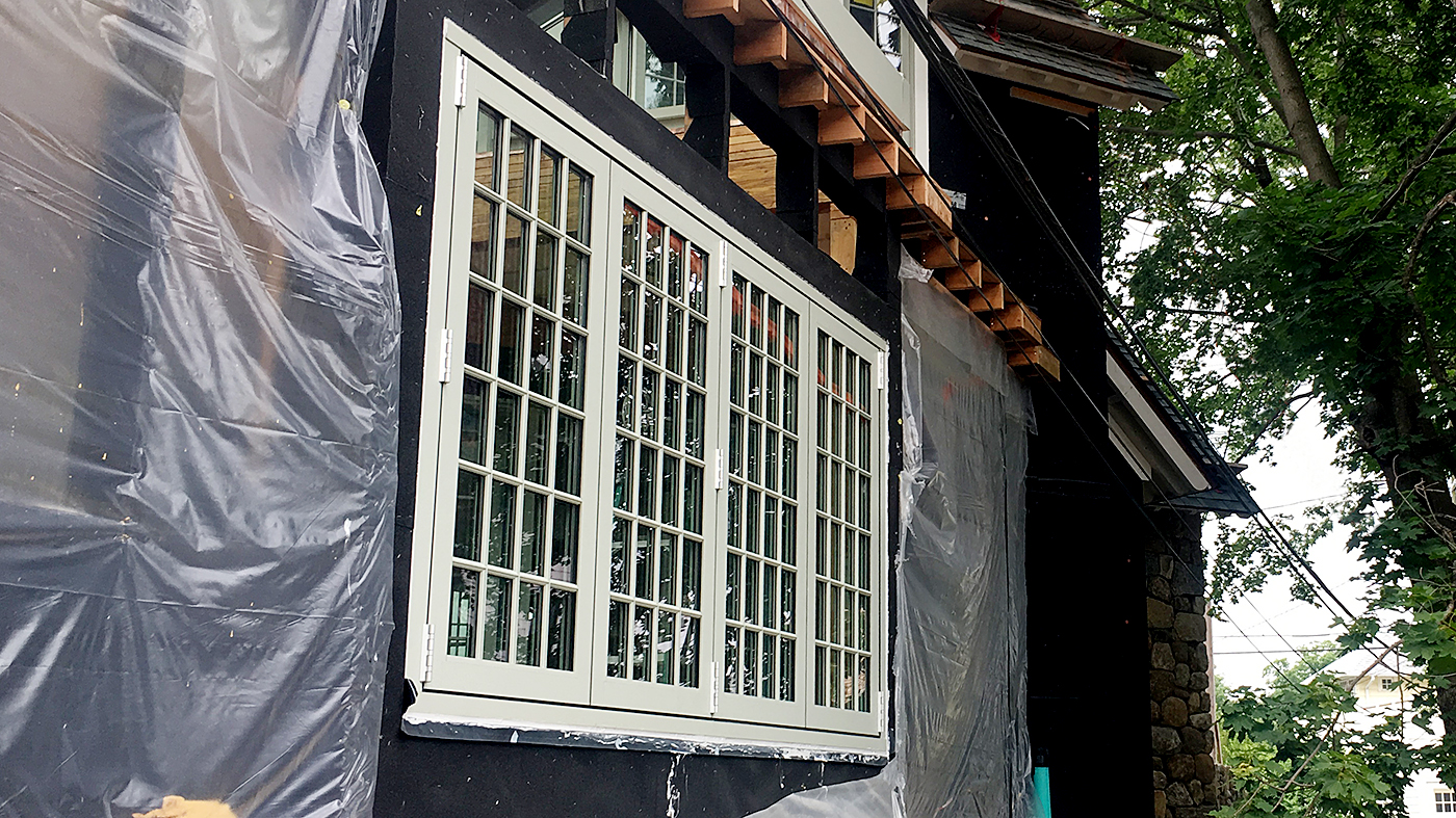 Bifold windows and straight eave double pitch skylight