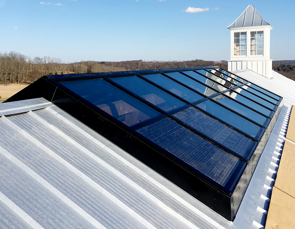 Straight eave double pitch ridge-mounted skylight