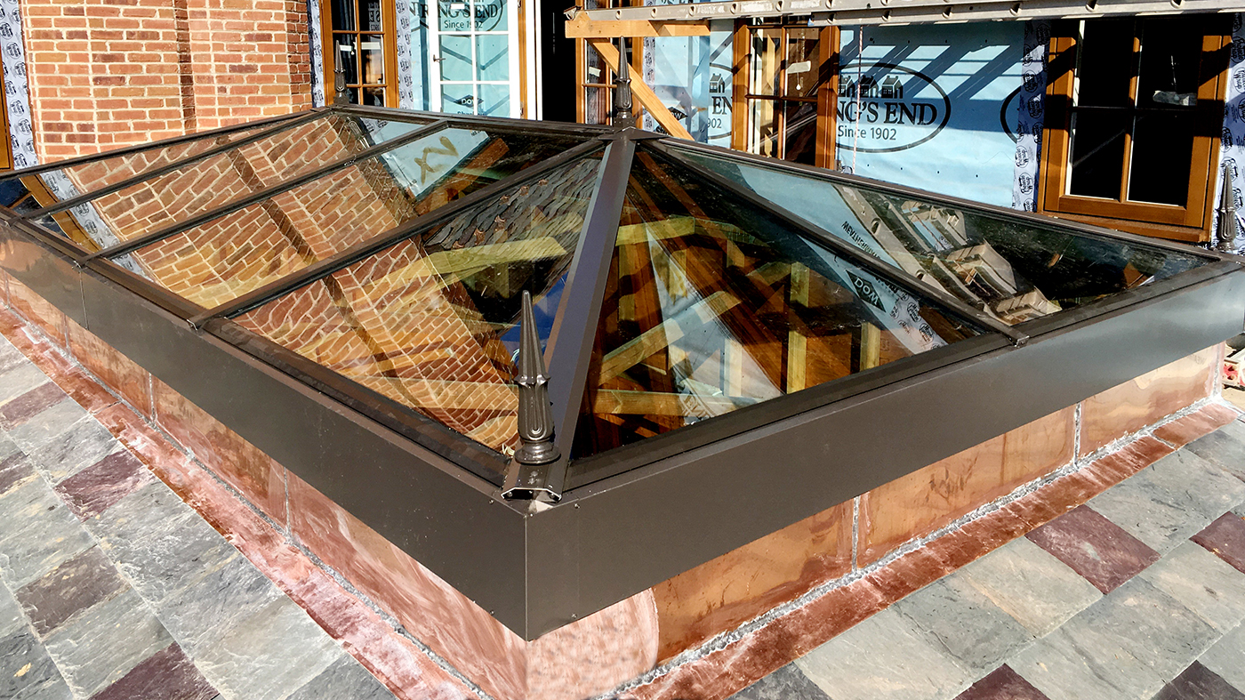 Straight eave double pitch, curb mount skylight
