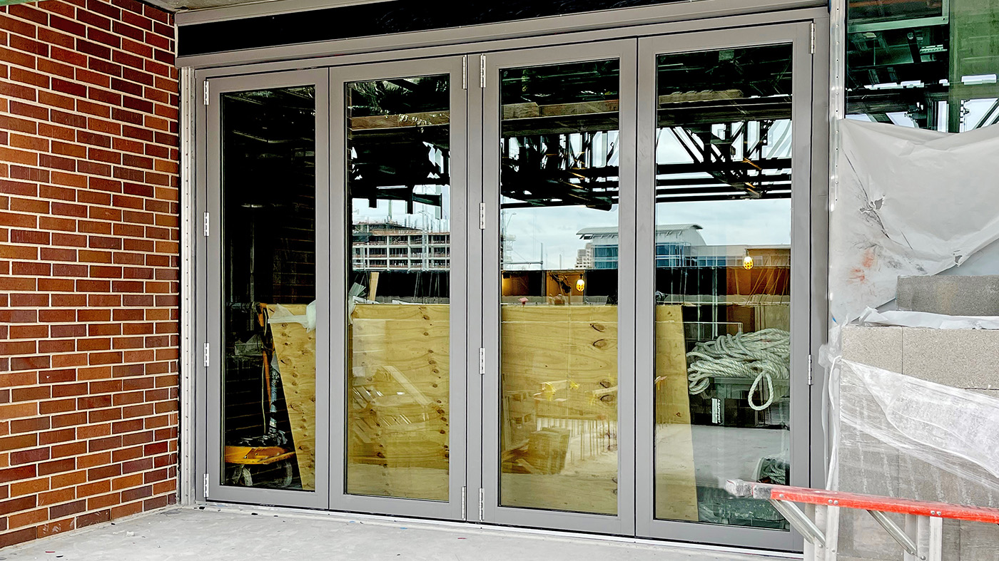 Two sets of four-panel bifold doors, each with a floating jamb