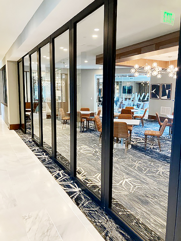 Slide & Stack Wall Systems with Single In-Swing Door