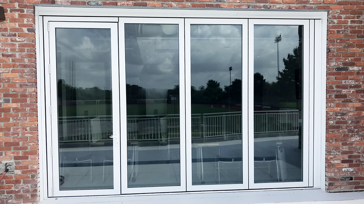 Slide and Stack Wall Systems with Outswing Single Door