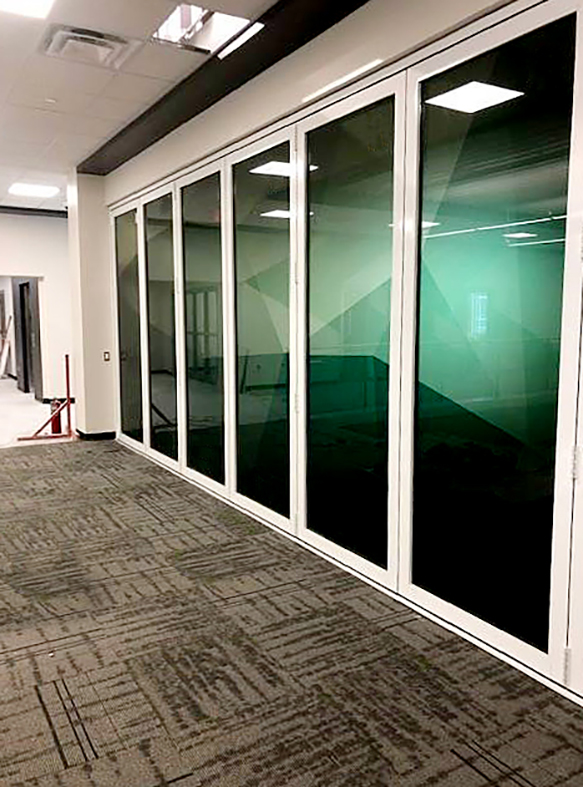 Bifold doors with translucent film applied