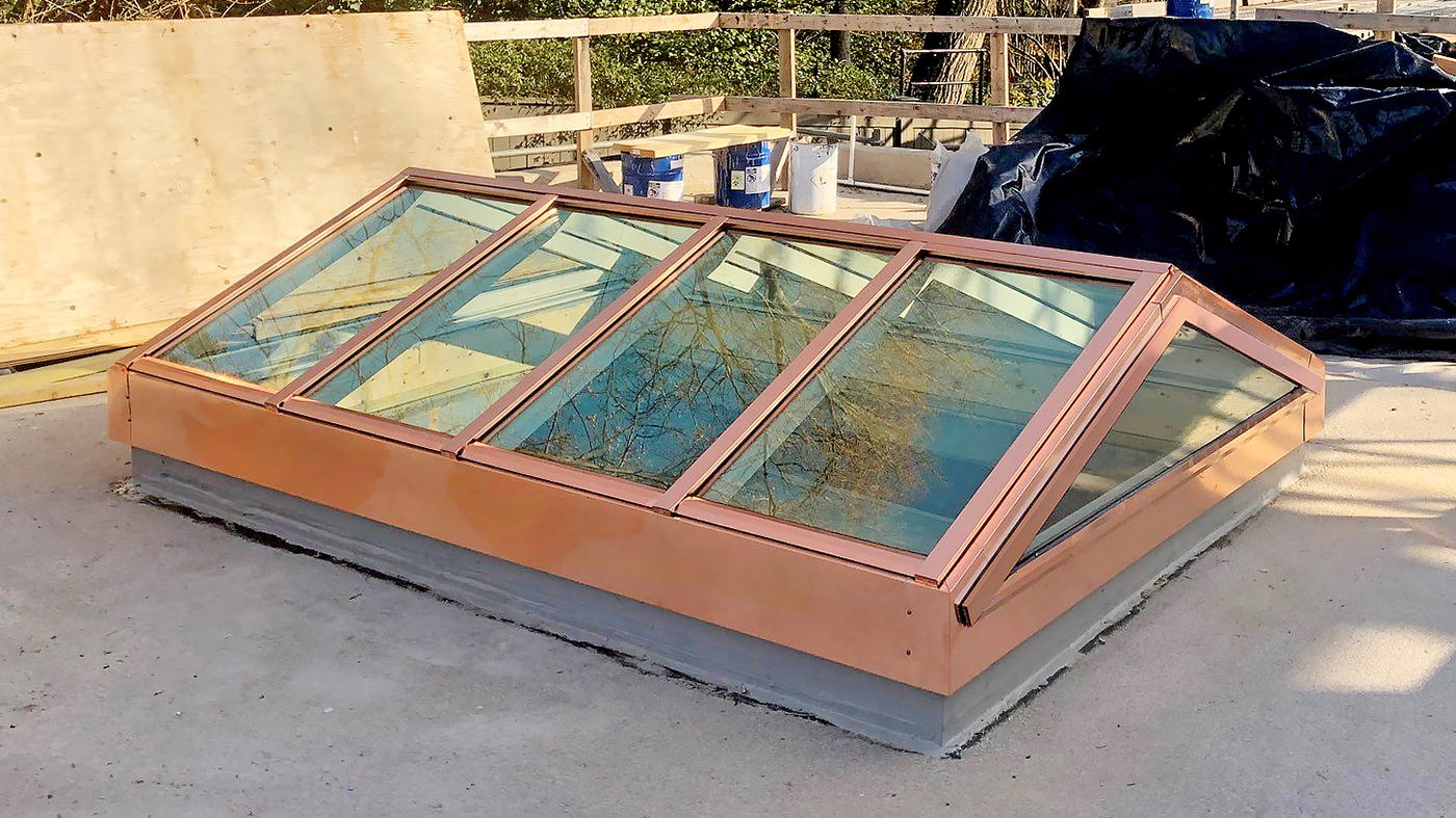 Two straight eave double pitch copper-clad skylights (one pictured)