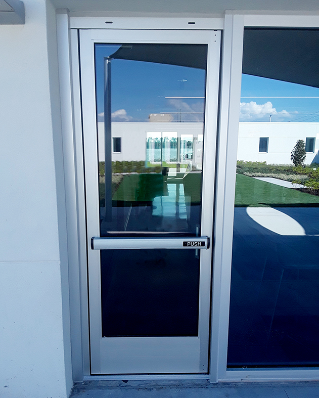 Swing door with panic hardware