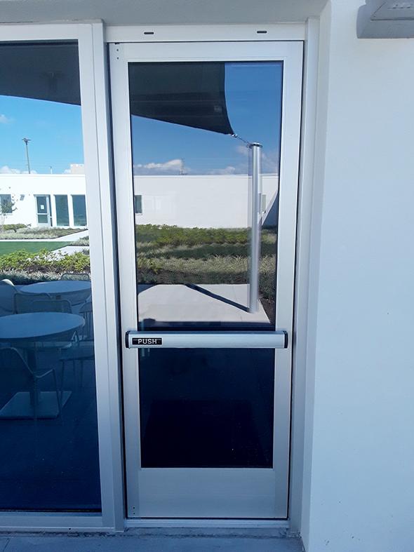 Swing door with panic hardware