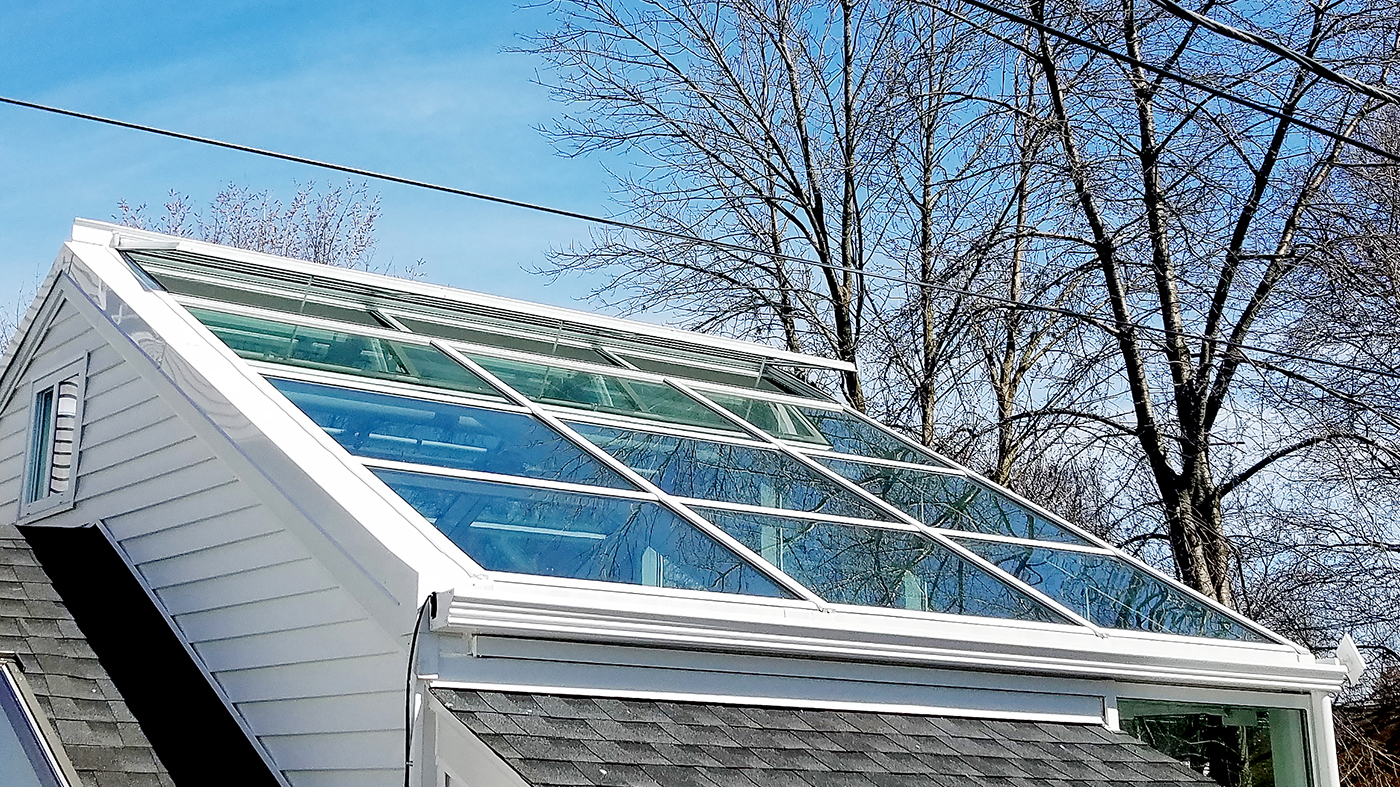 Straight eave double pitch greenhouse with a canopy over the entryway