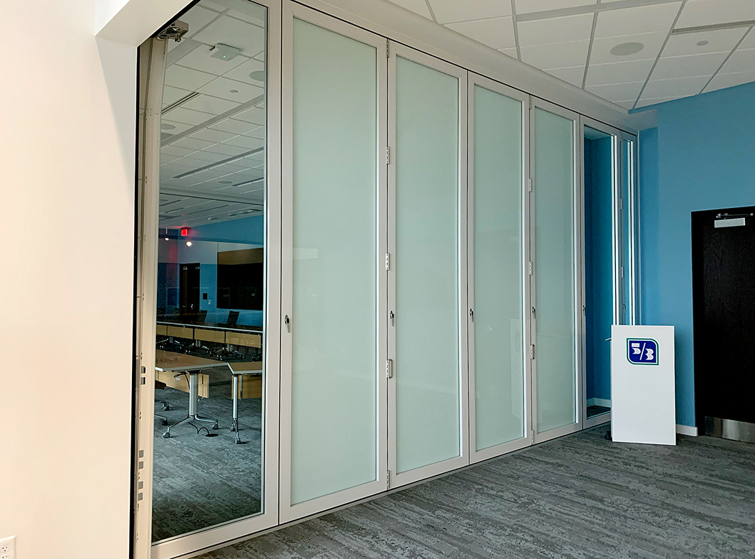 Six sets of bifold doors, three of which feature white PVB interlayer glazing
