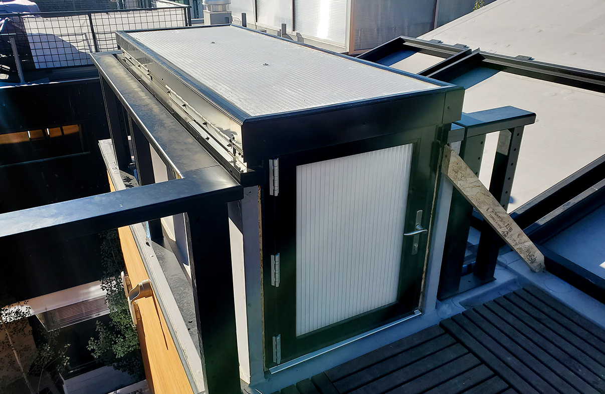 85-90 degree operable skylight with terrace door. Infill is 25mm Clear Lumira Aerogel Polycarbonate