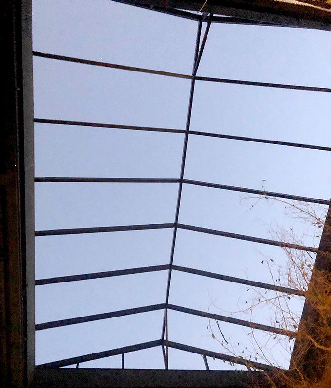 Straight eave double pitch skylight with two gable ends