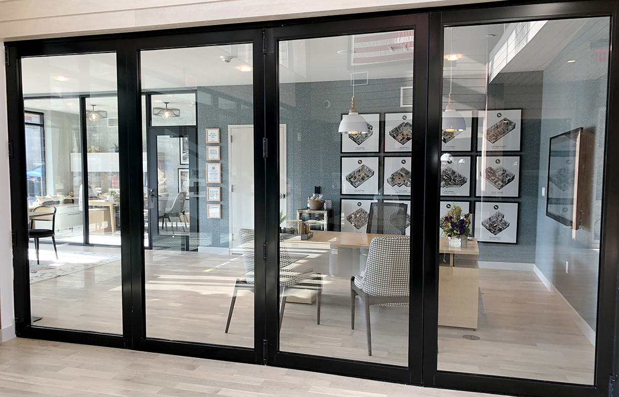 Two bifold door systems with two-point locking handle details
