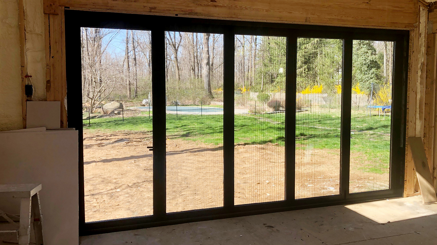 Three sets of bifold doors with B-Series retractable screens