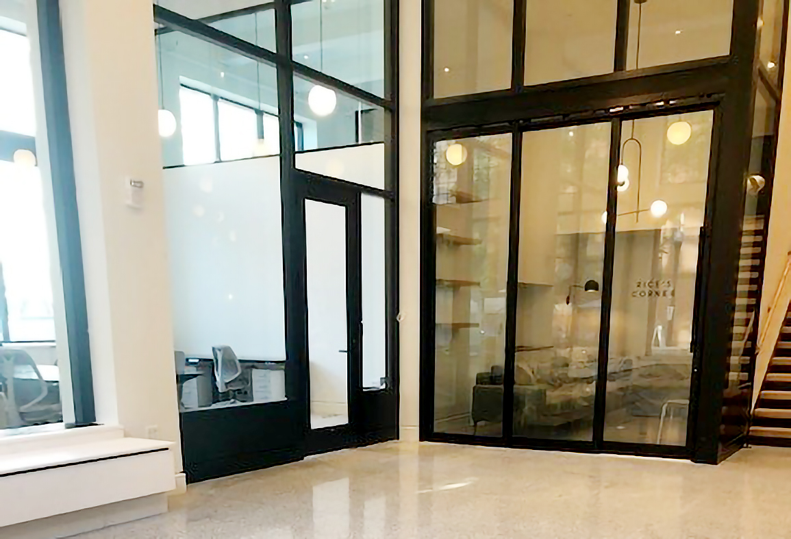 One nine-panel bifold door system and one three-panel multi-track sliding glass door system