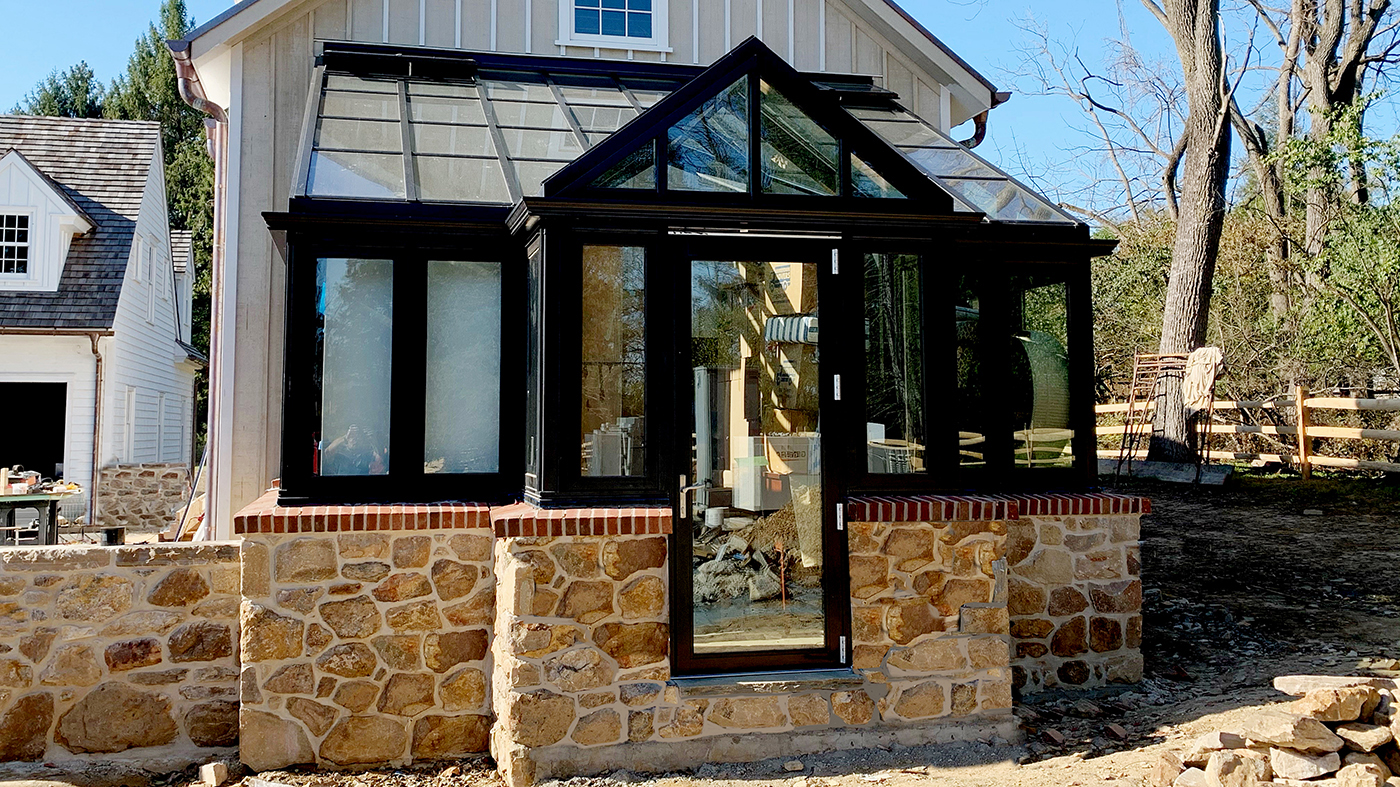 Straight eave lean to sunroom with a dormer entryway