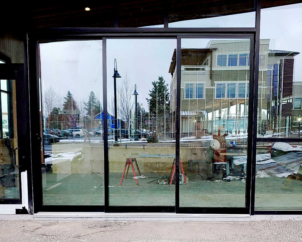 Two Multi-track Sliding Glass Door Systems