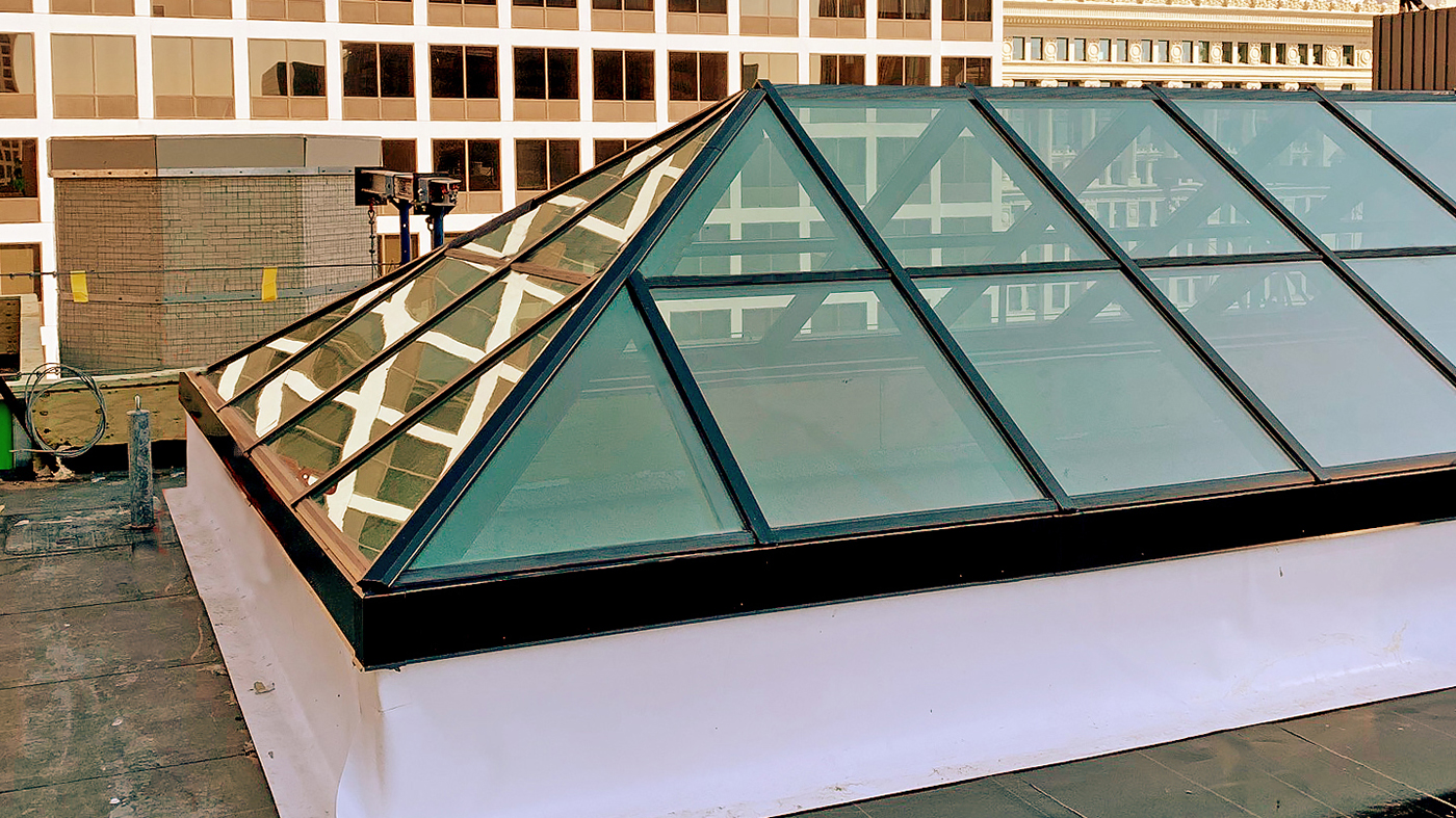 Straight eave double pitch hip end skylight and a six-panel bifold door with mullions