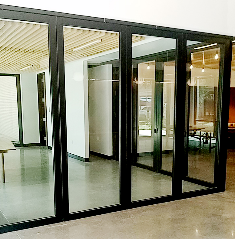 One Standard Bifold door system and one No Corner Post Bifold door system