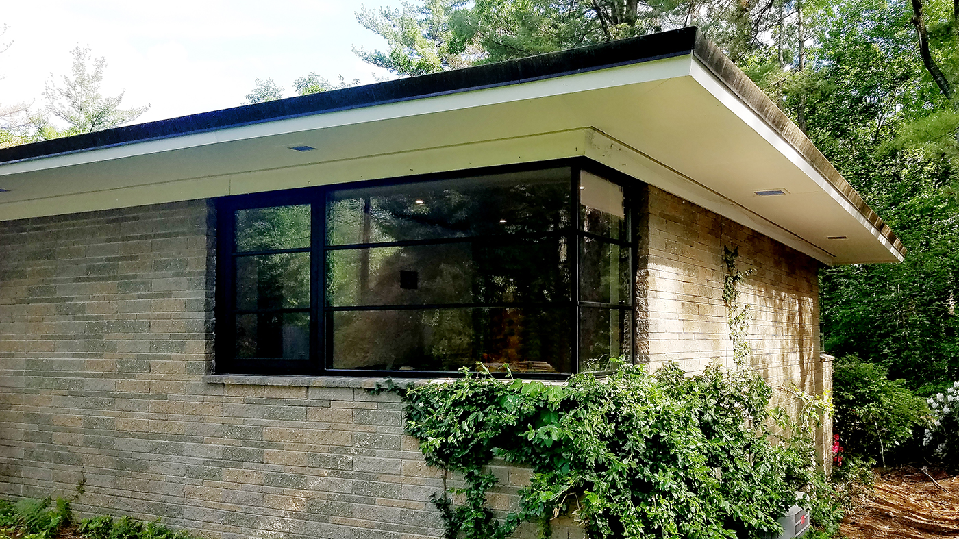 Nine aluminum curtain walls, three with integrated casement windows and two with integrated French Doors. One Sliding glass door an one French Door, each with horizontal grids.