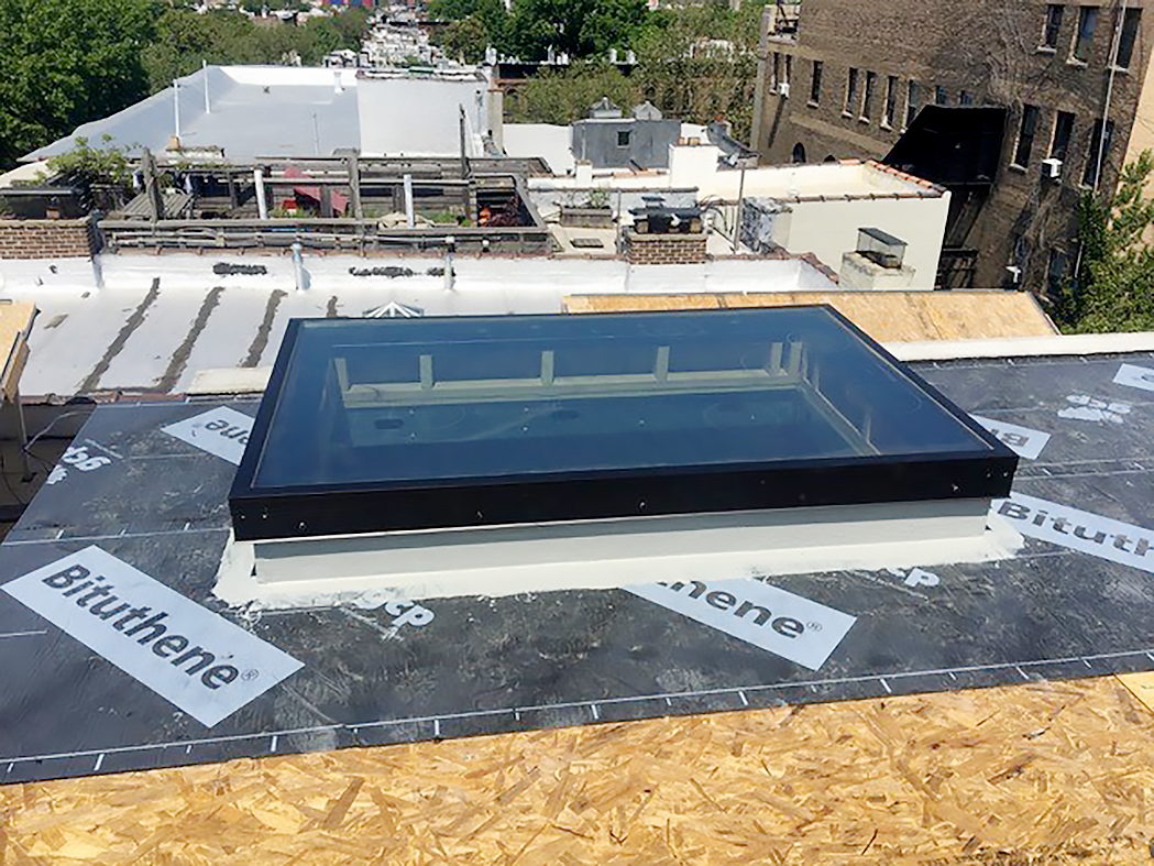 Two multi-track sliding glass doors, one flat skylight, and one round skylight