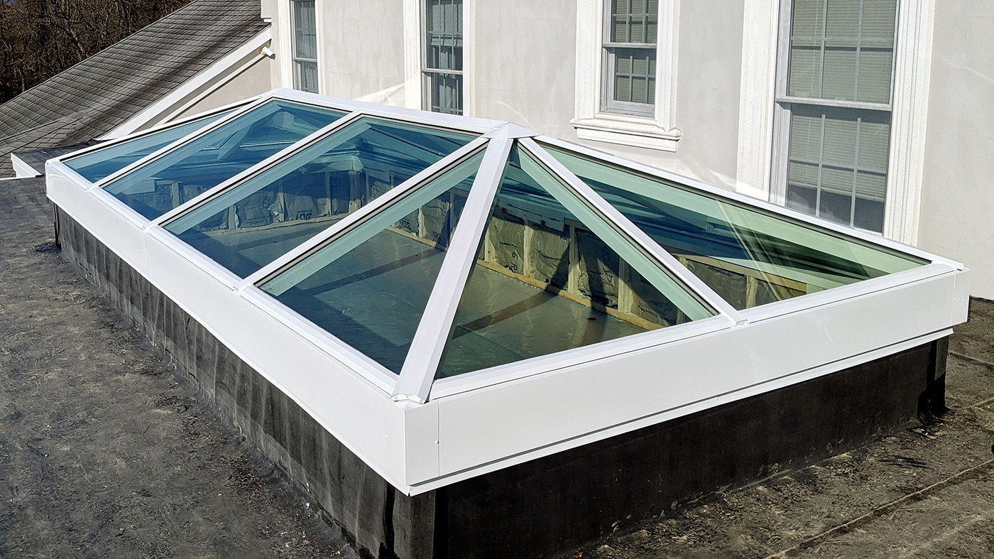 Straight eave double pitch skylight with two hip ends
