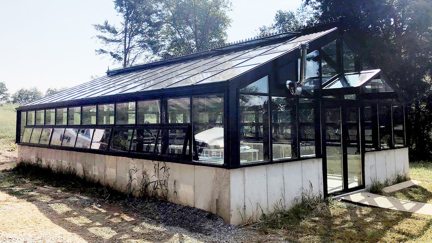 Straight eave double pitch greenhouse with cross-bracing
