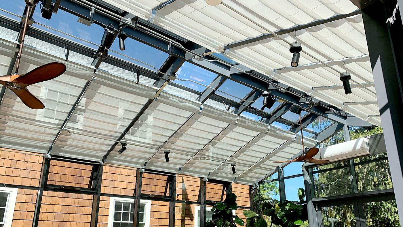 Straight eave double pitch conservatory with two sets of French doors