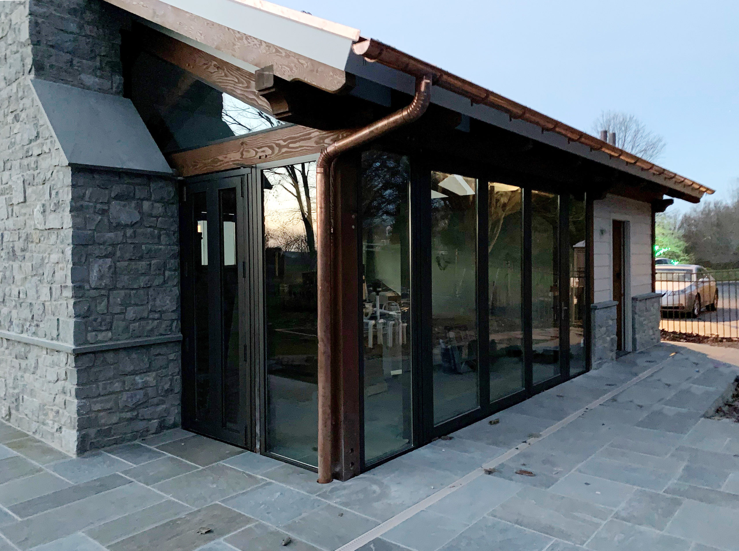 Four sets of bifold doors incorporated into a pool cabana