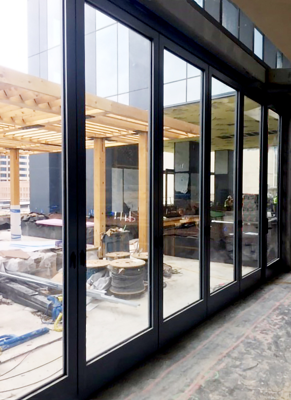 Three sets of slide and stack door systems