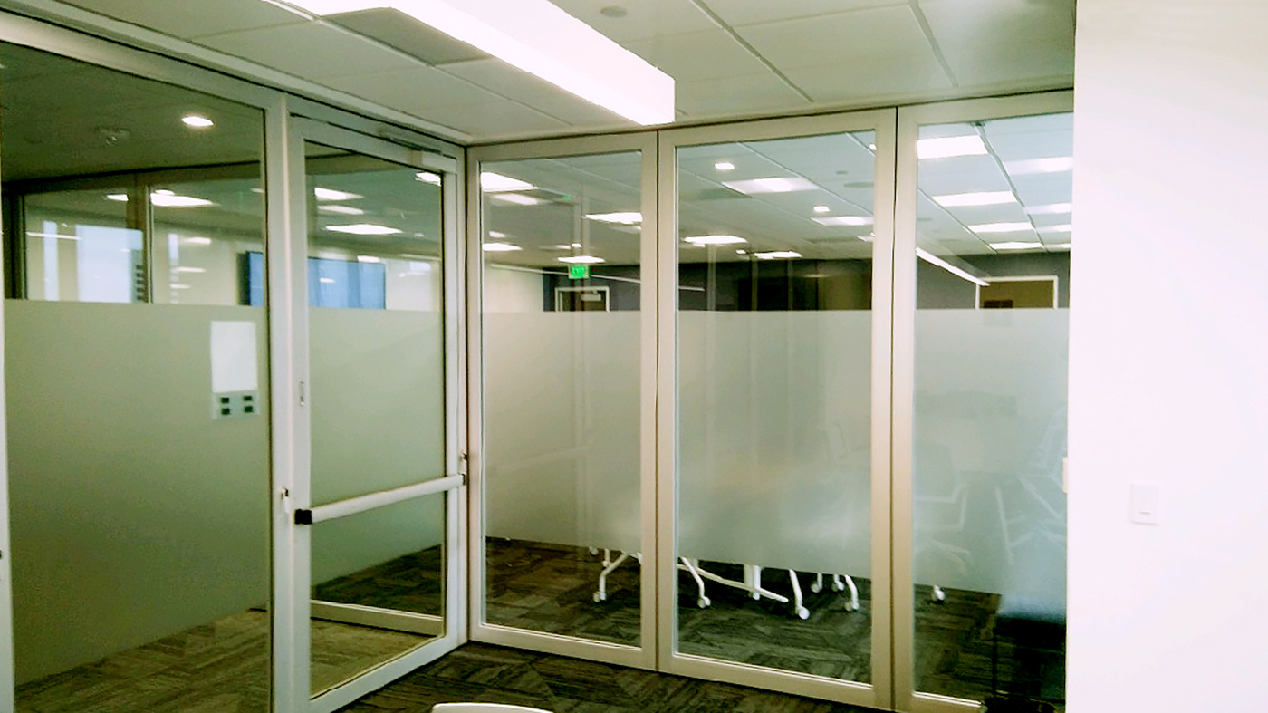 Three Slide and Stack Wall Systems; two with partially frosted glazed panels