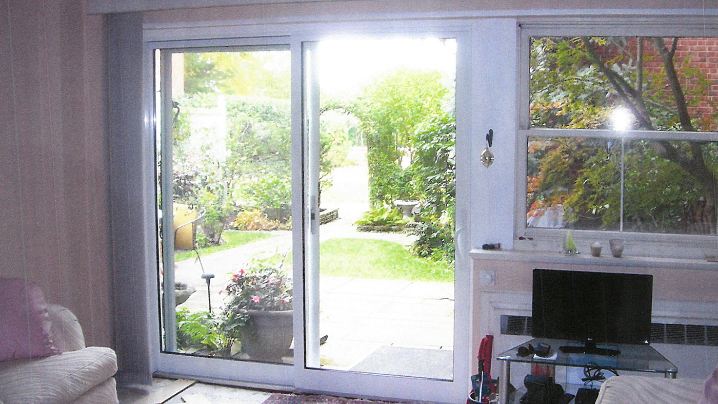Multi track sliding glass door